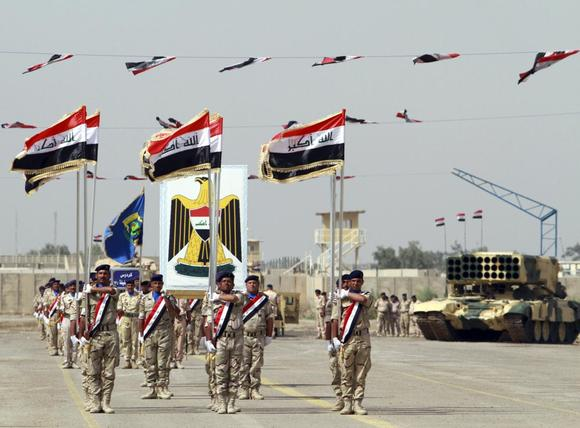 Iraqi Army soldiers march as part of a parade marking the founding anniversary of the army's artillery section in Baghdad October 1, 2014. REUTERS/Mahmoud Raouf Mahmoud