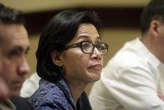 World Bank's Managing Director and Chief Operating Officer Sri Mulyani Indrawati listens to a question from a journalist during a news conference in Managua, July 10, 2014. REUTERS/Oswaldo Rivas
