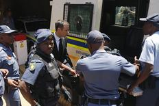 South African Olympic and Paralympic sprinter Oscar Pistorius enters a police van after his sentencing at the North Gauteng High Court in Pretoria October 21, 2014. REUTERS/Siphiwe Sibeko