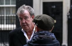 "BBC automobile program ""Top Gear"" presenter Jeremy Clarkson speaks with a member of his crew while filming a segment outside 10 Downing Street in London November 29, 2011. REUTERS/Suzanne Plunkett"