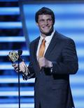 Carolina Panthers Luke Kuechly accepts the award for the NFL Defensive Player of the Year during the NFL Honors award show in New York February 1, 2014. REUTERS/Carlo Allegri