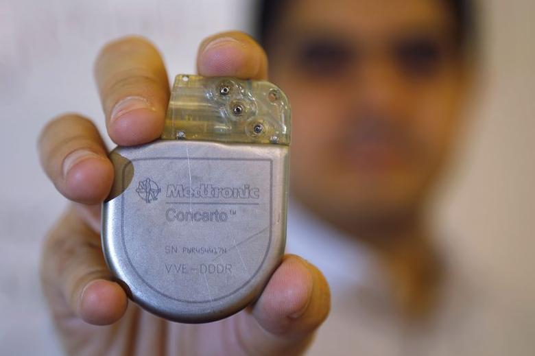 Massachusetts Institute of Technology researcher and graduate student Haitham Al-Hassanieh holds one of the Medtronic heart defibrillators he successfully attacked, at MIT in Cambridge, Massachusetts October 10, 2014. REUTERS/Brian Snyder