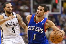 Apr 5, 2014; Philadelphia, PA, USA; Philadelphia 76ers guard Michael Carter-Williams (1) is defended by Brooklyn Nets guard Deron Williams (8) during the first quarter at the Wells Fargo Center. Mandatory Credit: Howard Smith-USA TODAY Sports