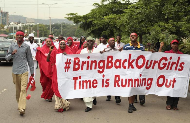 Campaigners from ''#Bring Back Our Girls'' march during a rally calling for the release of the Abuja school girls who were abducted by Boko Haram militants, in Abuja October 17, 2014. REUTERS/Afolabi Sotunde