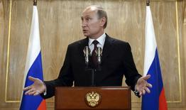 """Russia's President Vladimir Putin gestures as he speaks during a news conference after the Asia-Europe Meeting (ASEM) in Milan, October 17, 2014. Russian President Putin said on Friday he and his Ukrainian counterpart Petro Poroshenko had agreed on the terms of Russian natural gas supplies """"at least for the winter period"""". REUTERS/Vasily Maximov/Pool (ITALY - Tags: POLITICS ENERGY)"""