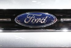 The company logo is seen on the bonnet of a Ford car during the media day ahead of the 84th Geneva Motor Show at the Palexpo Arena in Geneva March 5, 2014. REUTERS/Arnd Wiegmann/Files