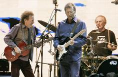 Legendary trio Cream (L-R) bassist Jack Bruce, guitarist Eric Clapton and drummer Ginger Baker perform at Madison Square Garden in New York October 24, 2005. REUTERS/Brendan McDermid