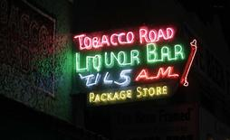 A view of the neon sign belonging to the Tobacco Road bar in Miami, October 23, 2014.  REUTERS/Andrew Innerarity