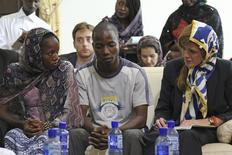 At the Grand Mosque, U.S. Ambassador to the United Nations, Samantha Power, meets with Ebola survivors Fanta Oulen Camara, 24, (L) and Dr Oulare Bakary, 30 (C) in Conakry, Guinea October 26, 2014. REUTERS/Michelle Nichols