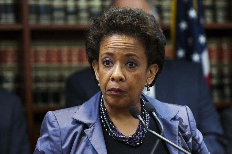 United States Attorney Loretta E. Lynch speaks during an announcement of the arrest of Abraxas J. (''A.J.'') Discala, CEO of OmniView Capital, and six co-conspirators for fraudulent market manipulation at the U.S. Attorney's office in Brooklyn, New York July 17, 2014. REUTERS/Lucas Jackson
