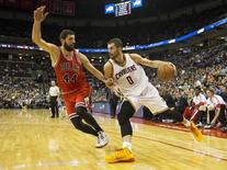 Oct 20, 2014; Columbus, OH, USA; Cleveland Cavaliers forward Kevin Love (0) drives past Chicago Bulls forward Nikola Mirotic (44) at Value City Arena. Cleveland won the game 107-98. Mandatory Credit: Greg Bartram-USA TODAY Sports