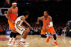 New York Knicks shooting guard J.R. Smith (8) drives around New Orleans Pelicans small forward Josh Childress (8) during the first quarter at Madison Square Garden. Anthony Gruppuso-USA TODAY Sports
