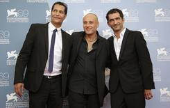 "Egyptian director Ibrahim El Batout (C) poses with actors Salah Al Hanafy (L) and Amr Waked during the photocall of the movie ""El sheita elli fat (Winter of discontent)"" at the 69th Venice Film Festival in Venice September 1, 2012. REUTERS/Max Rossi"