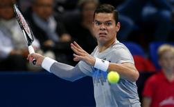 Canada's Milos Raonic eyes the ball during his match against Donald Young of the U.S. at the Swiss Indoors ATP tennis tournament in Basel October 23, 2014.   REUTERS/Arnd Wiegmann