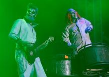Members of Slipknot, Shawn Crahan (R) and Jim Root, perform during the Download music festival in Castle Donington, central England, in this June 14, 2013, file photo. REUTERS/Darren Staples/Files