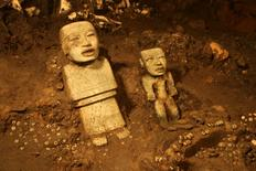 Stone figurines are seen in a tunnel that may lead to a royal tombs discovered at the ancient city of Teotihuacan, in this November 19, 2013 National Institute of Anthropology and History (INAH) handout picture made available to Reuters October 29, 2014. REUTERS/INAH/Handout via Reuters