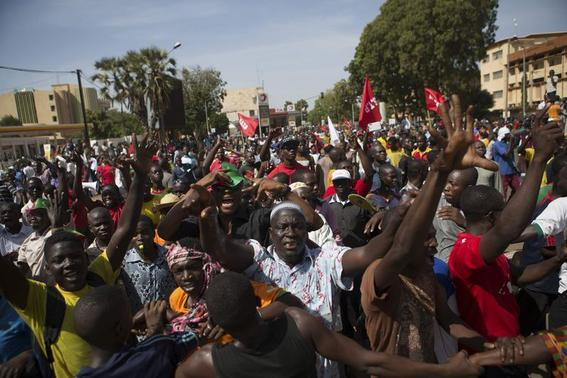 1 of 2. People march against Burkina Faso President Blaise Compaore's plan to change the constitution to stay in power in Ouagadougou, capital of Burkina Faso, October 29, 2014.  Credit: Reuters/Joe Penney