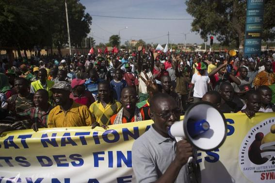 2 of 2. People march against Burkina Faso President Blaise Compaore's plan to change the constitution to stay in power in Ouagadougou, capital of Burkina Faso, October 29, 2014. Credit: REUTERS/Joe Penney