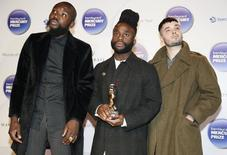 Young Fathers pose with their trophy after winning the 2014 Mercury Prize in London October 29, 2014  REUTERS/Paul Hackett