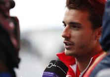 Marussia Formula One driver Jules Bianchi of France speaks to the media after a news conference at the Suzuka circuit October 2, 2014. REUTERS/Yuya Shino