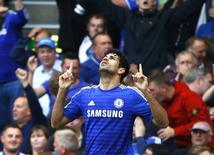 Diego Costa comemora gol contra o Arsenal durante partida em Londres. 5/10/2014 REUTERS/Eddie Keogh