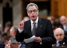 Canada's Finance Minister Joe Oliver speaks during Question Period in the House of Commons on Parliament Hill in Ottawa October 29, 2014. REUTERS/Chris Wattie