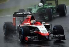 Marussia Formula One driver Jules Bianchi of France drives in front of Caterham Formula One driver Kamui Kobayashi of Japan during the Japanese F1 Grand Prix at the Suzuka Circuit October 5, 2014. REUTERS/Yuya Shino