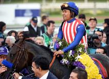 November 1, 2014; Santa Anita , CA, USA; Martin Garcia, jockey of Bayern celebrates victory of race twelve following the 2014 Breeders Cup Championships at Santa Anita Park. Mandatory Credit: Richard Mackson-USA TODAY Sports