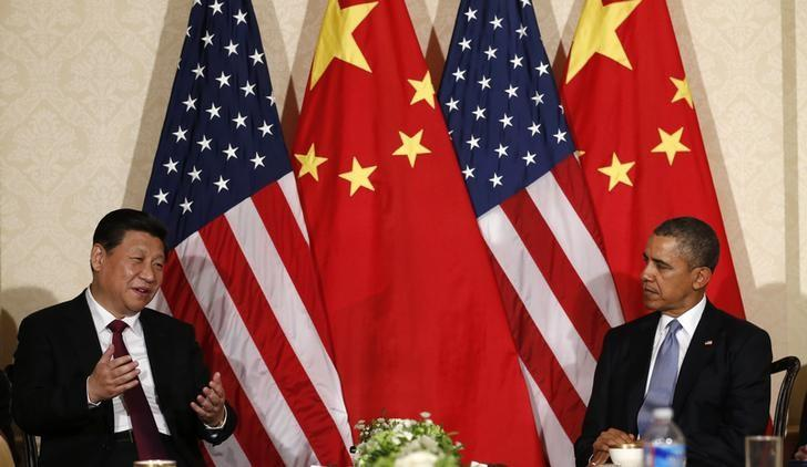 China's President Xi Jinping speaks during his meeting with U.S. President Barack Obama (R), on the sidelines of a nuclear security summit, in The Hague March 24 2014. REUTERS/Kevin Lamarque/Files