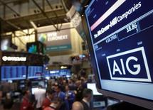 The American International Group, Inc. (AIG) stock ticker is seen on a monitor as traders work on the floor of the New York Stock Exchange after the opening bell February 11, 2013.  REUTERS/Brendan McDermid