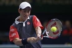 Kei Nishikori of Japan returns a shot during his men's singles quarter-final tennis match against David Ferrer of Spain at the Paris Masters tennis tournament at the Bercy sports hall in Paris, October 31, 2014. REUTERS/Benoit Tessier
