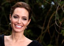 Actress Angelina Jolie arrives for a special Maleficent Costume Display at Kensington Palace in London in ths file photo taken May 8, 2014.   REUTERS/Luke MacGregor/Files