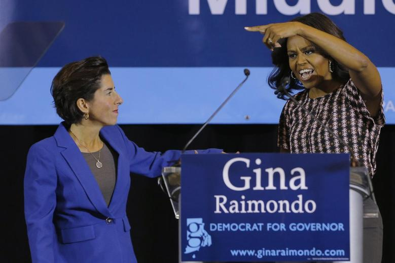 Michelle Obama gestures to Democratic candidate for Rhode Island Governor Gina Raimondo at a campaign rally in Providence,October 30, 2014. REUTERS/Brian Snyder