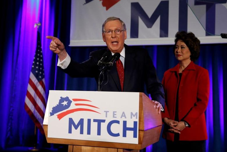 U.S. Senate Minority Leader Mitch McConnell (R-KY) addresses supporters while accompanied by his wife, former United States Secretary of Labor Elaine Chao, at his midterm election night victory rally in Louisville, Kentucky, November 4, 2014.  REUTERS/Shannon Stapleton