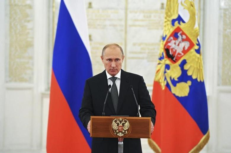 Russian President Vladimir Putin delivers a speech during a meeting with senior officers who attained higher ranks at the Kremlin in Moscow, October 31, 2014. REUTERS/Michael Klimentyev/RIA Novosti/Kremlin