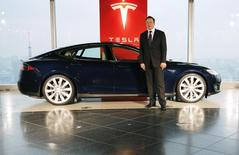 Tesla Motors Inc Chief Executive Elon Musk poses with a Tesla Model S electric car in Tokyo September 8, 2014.   REUTERS/Toru Hanai