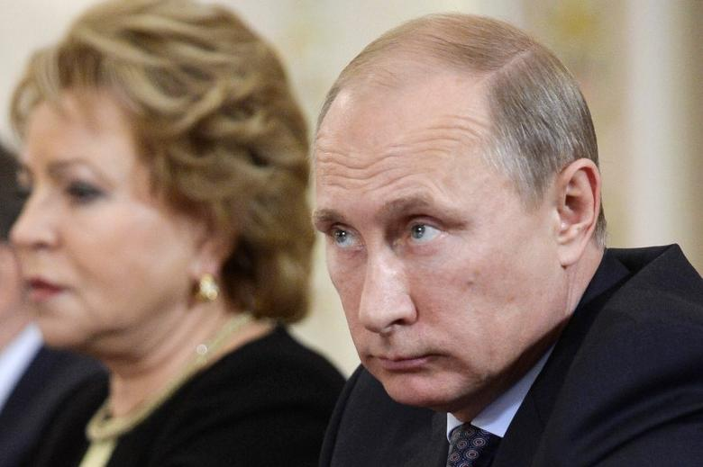 Russia's President Vladimir Putin and head of the Federation Council Valentina Matviyenko (L) attend a meeting with Parliament members of the Collective Security Treaty Organization at the Novo-Ogaryovo state residence outside Moscow November 6, 2014. REUTERS/Alexander Nemenov/Pool