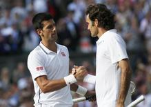 Novak Djokovic of Serbia shakes hands with Roger Federer of Switzerland after defeating him in their men's singles finals tennis match on Centre Court at the Wimbledon Tennis Championships in London July 6, 2014.          REUTERS/Sang Tan/Pool