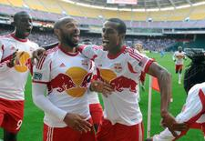 Nov 8, 2014; Washington, DC, USA; New York Red Bulls forward Thierry Henry (left) and defender Roy Miller (7) celebrate after a New York Red Bulls goal against the D.C. United during the second half at Robert F. Kennedy Memorial. Mandatory Credit: Brad Mills-USA TODAY Sports