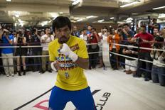 Boxer Manny Pacquiao of the Philippines trains during a media workout in Hong Kong October 27, 2014. REUTERS/Tyrone Siu