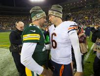 Nov 9, 2014; Green Bay, WI, USA; Green Bay Packers quarterback Aaron Rodgers (12) talks with Chicago Bears quarterback Jay Cutler (6) following the game at Lambeau Field.  Green Bay won 55-14.  Mandatory Credit: Jeff Hanisch-USA TODAY Sports