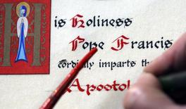 A calligrapher makes a papal blessing on parchment at a workshop in Rome November 7, 2014. REUTERS/Stefano Rellandini