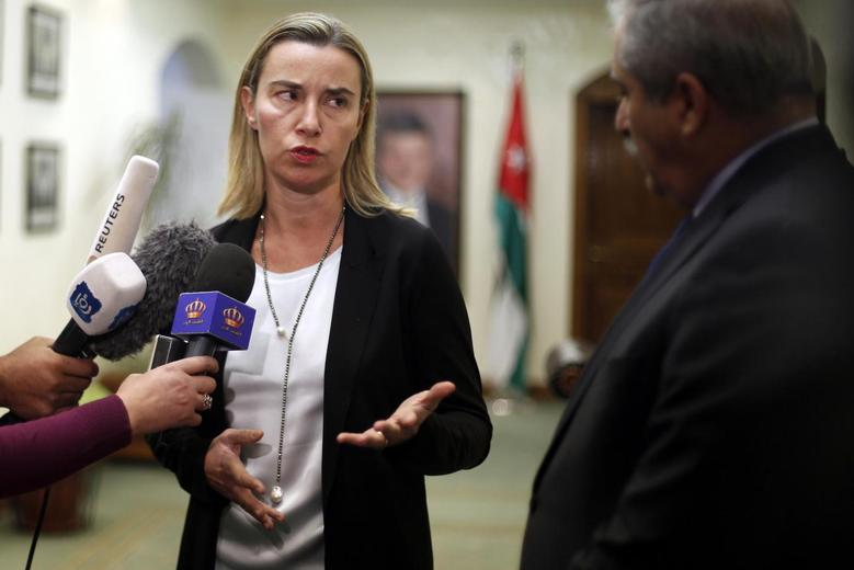 European Union foreign policy chief Federica Mogherini speaks to the media after a meeting with Jordanian Foreign Minister Nasser Judeh (R) at the Foreign Affairs Ministry in Amman November 9, 2014. REUTERS/Muhammad Hamed