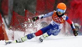 Vanessa Mae, competing for Thailand under her father's name Vanakorn, skis during the first run of the women's alpine skiing giant slalom event at the 2014 Sochi Winter Olympics at the Rosa Khutor Alpine Center, in this file picture taken February 18, 2014. Pop violinist Mae has been banned by the International Ski Federation (FIS) for four years over the manipulation of giant slalom races which allowed her to qualify for the Sochi Olympic Games.   REUTERS/Stefano Rellandini (RUSSIA - Tags: SPORT SKIING OLYMPICS ENTERTAINMENT)