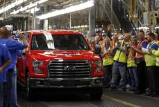 Ford Motor assembly workers celebrate as the all-new 2015 F-150 pick-up truck is driven off the line during a launch celebration at the Ford Rouge Center in Dearborn, Michigan, November 11, 2014. Reuters/Rebecca Cook