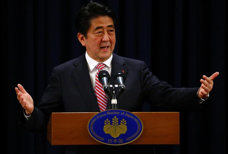 Japan's Prime Minister Shinzo Abe, in the country for the Asia Pacific Economic Cooperation (APEC) forum, gestures as he talks to the media at a news conference in Beijing November 11, 2014. REUTERS/Petar Kujundzic