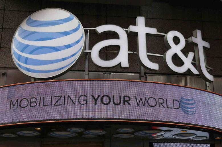 The signage for an AT&T store is seen in New York October 29, 2014. REUTERS/Shannon Stapleton