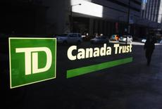 A Toronto-Dominion Canada Trust bank sign is seen as people walk by in Toronto, April 2, 2009.    REUTERS/Mark Blinch