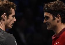 Roger Federer of Switzerland (R) embraces Andy Murray of Britain (L) after defeating Murray in their tennis match at the ATP World Tour finals at the O2 Arena in London November 13, 2014. REUTERS/Toby Melville