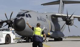 A flight supervisor leads an Airbus A400M into position for the ILA Berlin Air Show in Selchow near Schoenefeld south of Berlin, September 10, 2012.  REUTERS/Tobias Schwarz